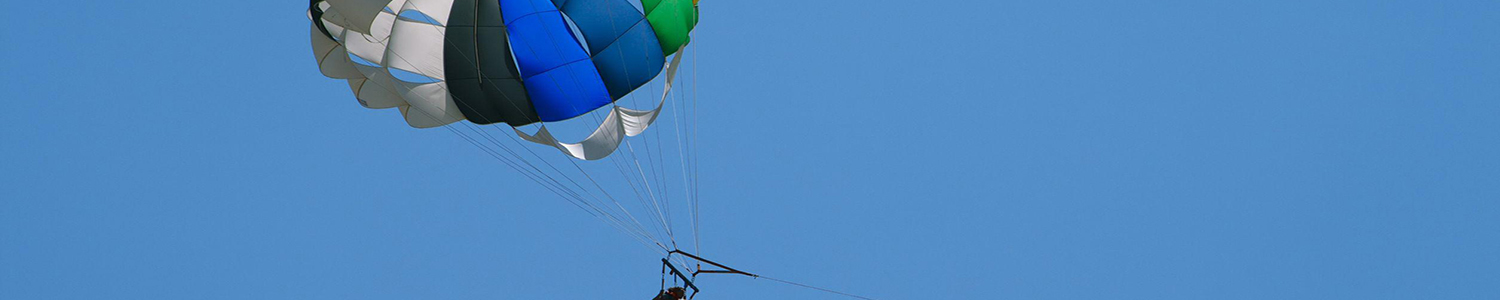 Photo of person parasailing.