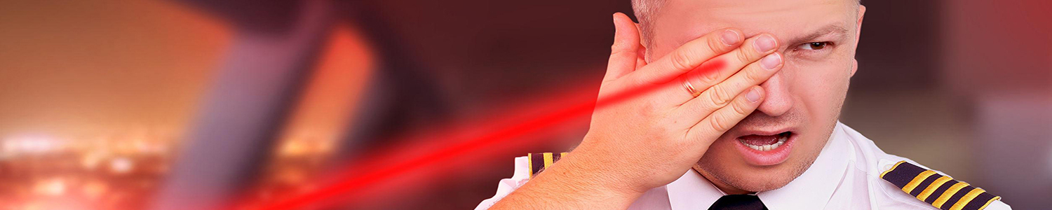 Photo of a pilot blinded by laser from the ground