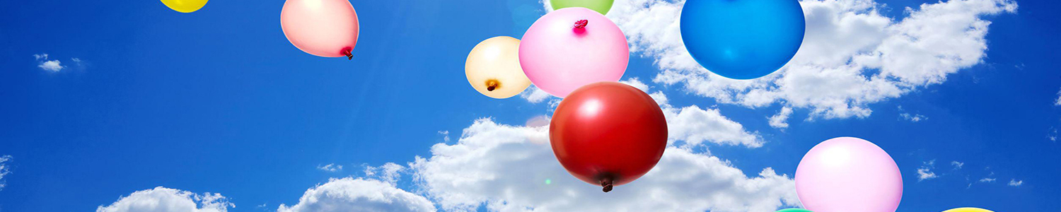 Photo of helium balloons against the sky