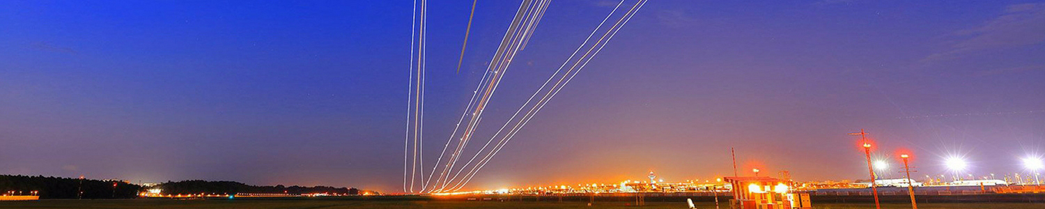 Photo of lightstreams in the night sky created by passing aircraft